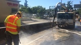 'We're struggling to get it off the pavement': Truck crash coats busy road in glue