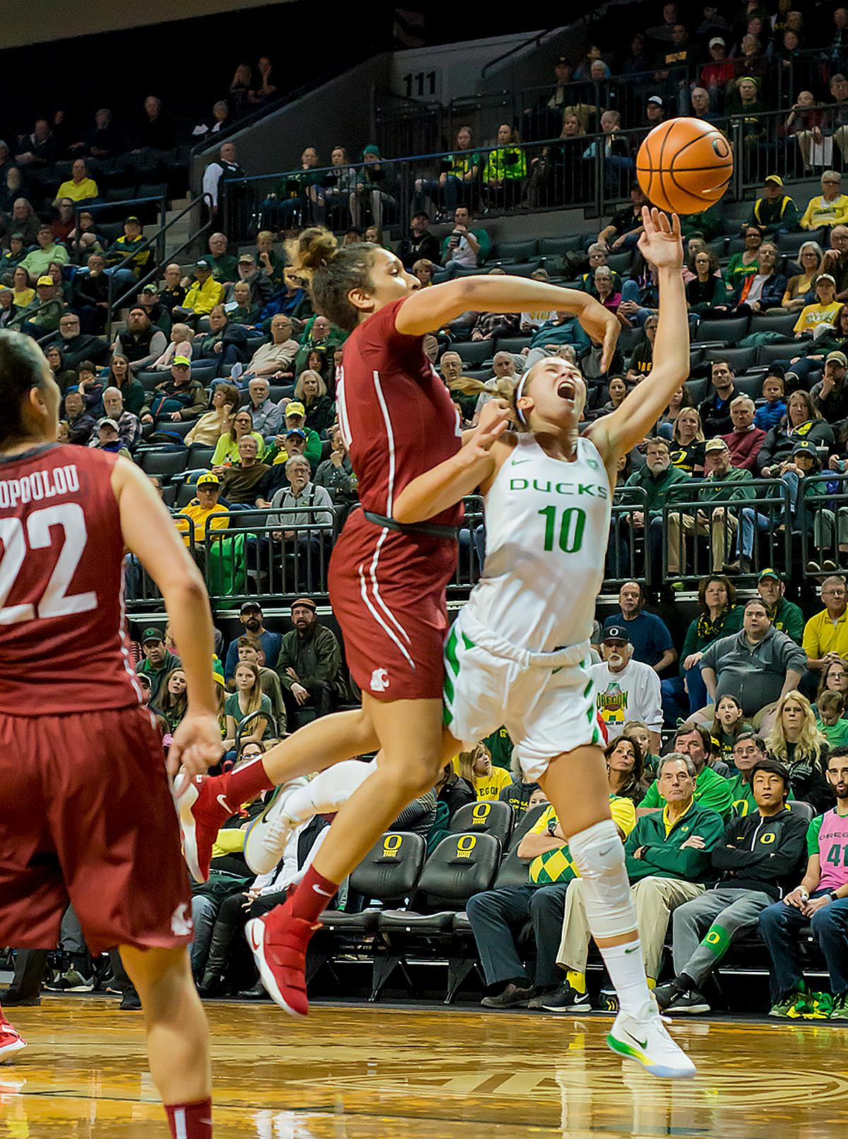 Washington State University Cougars Nike McClure (#21) blocks the shot of Oregon Ducks Lexi Bando (#10). In their first conference basketball game of the season, the Oregon Women Ducks defeated the Washington State Cougars 89-56 in Matt Knight Arena Saturday afternoon. Oregon's Ruthy Hebard ran up 25 points with 10 rebounds. Sabrina Ionescu shot 25 points with five three-pointers and three rebounds. Lexi Bando added 18 points, with four three-pointers and pulled down three rebounds. Satou Sabally ended the game with 14 points with one three-pointer and two rebounds. The Ducks are now 12-2 overall with 1-0 in conference and the Cougars stand at 7-6 overall and 0-1 in conference play. The Oregon Women Ducks next play the University of Washington Huskies at 1:00 pm on Sunday. Photo by Karly DeWees, Oregon News Lab