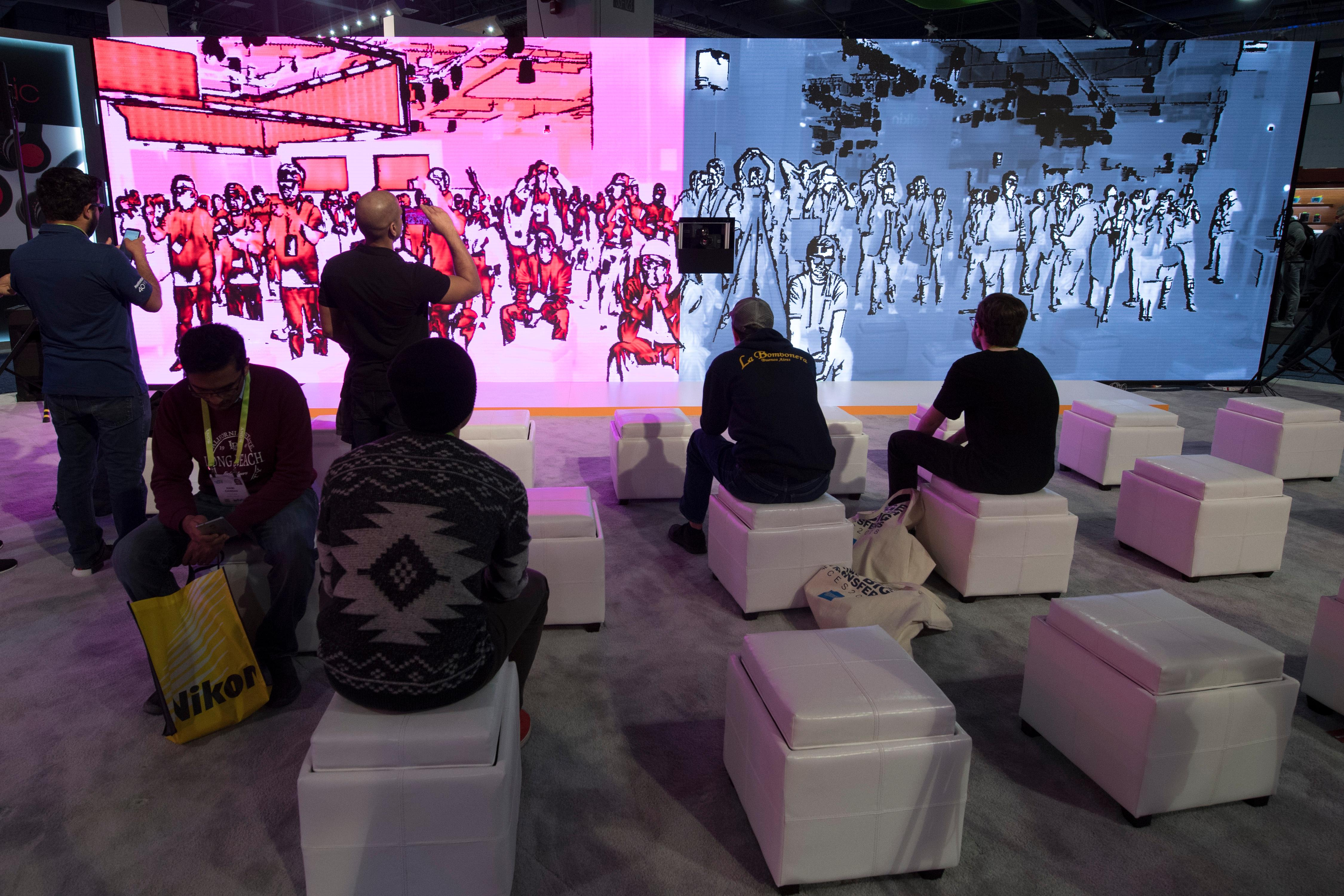 Attendees watch a live display at the FLIR booth during the second day of CES Wednesday, January 10, 2018, at the Las Vegas Convention Center. CREDIT: Sam Morris/Las Vegas News Bureau