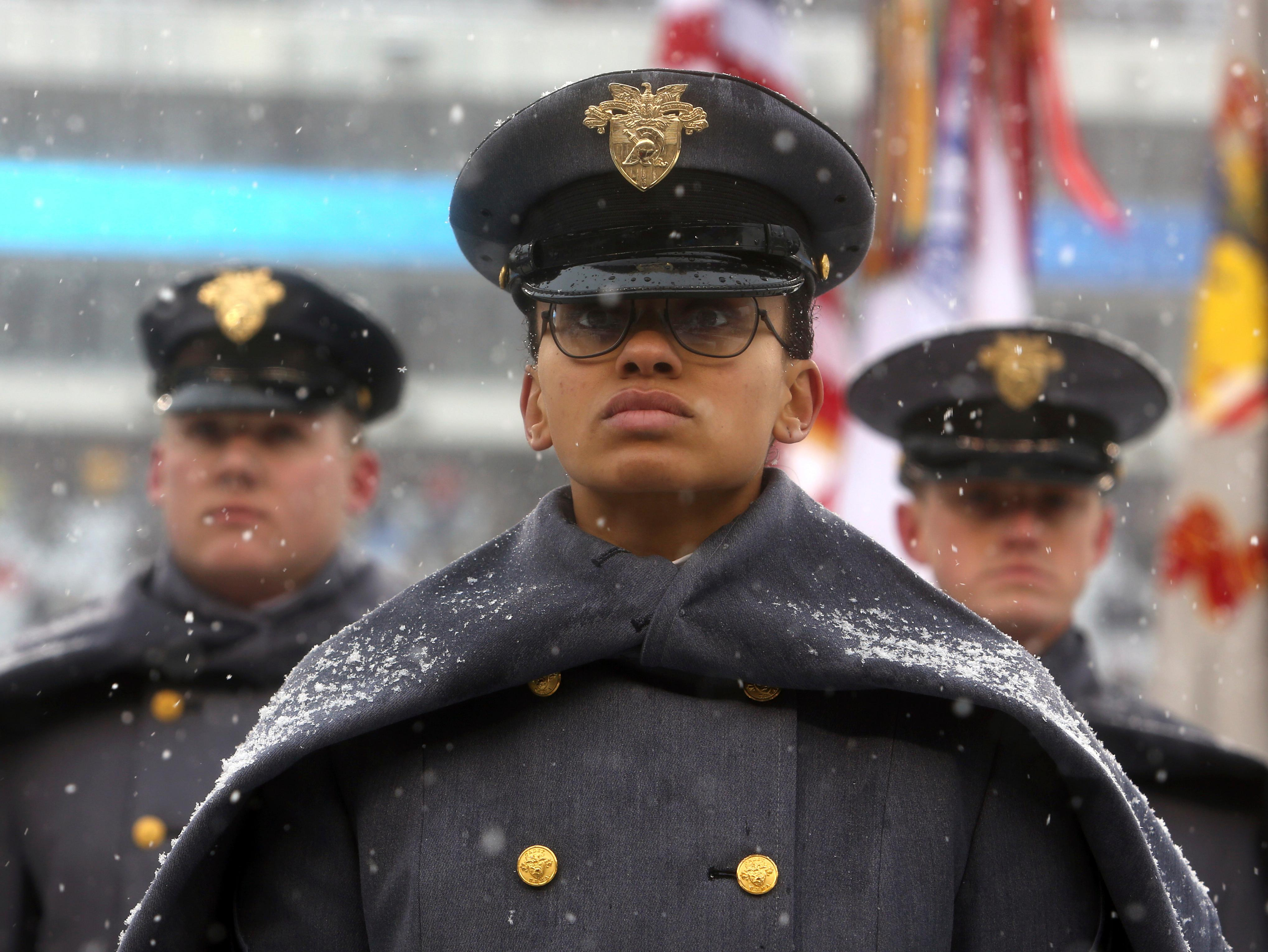 "First Captain Simone Askew, the first African-American woman to lead the Corps of Cadets at West Point, stands in formation as she leads the ""march on"" of Army Cadets before the 118th meeting of the annual Army Navy football game Saturday Dec. 9, 2017 in Philadelphia. (AP Photo/Jacqueline Larma)"