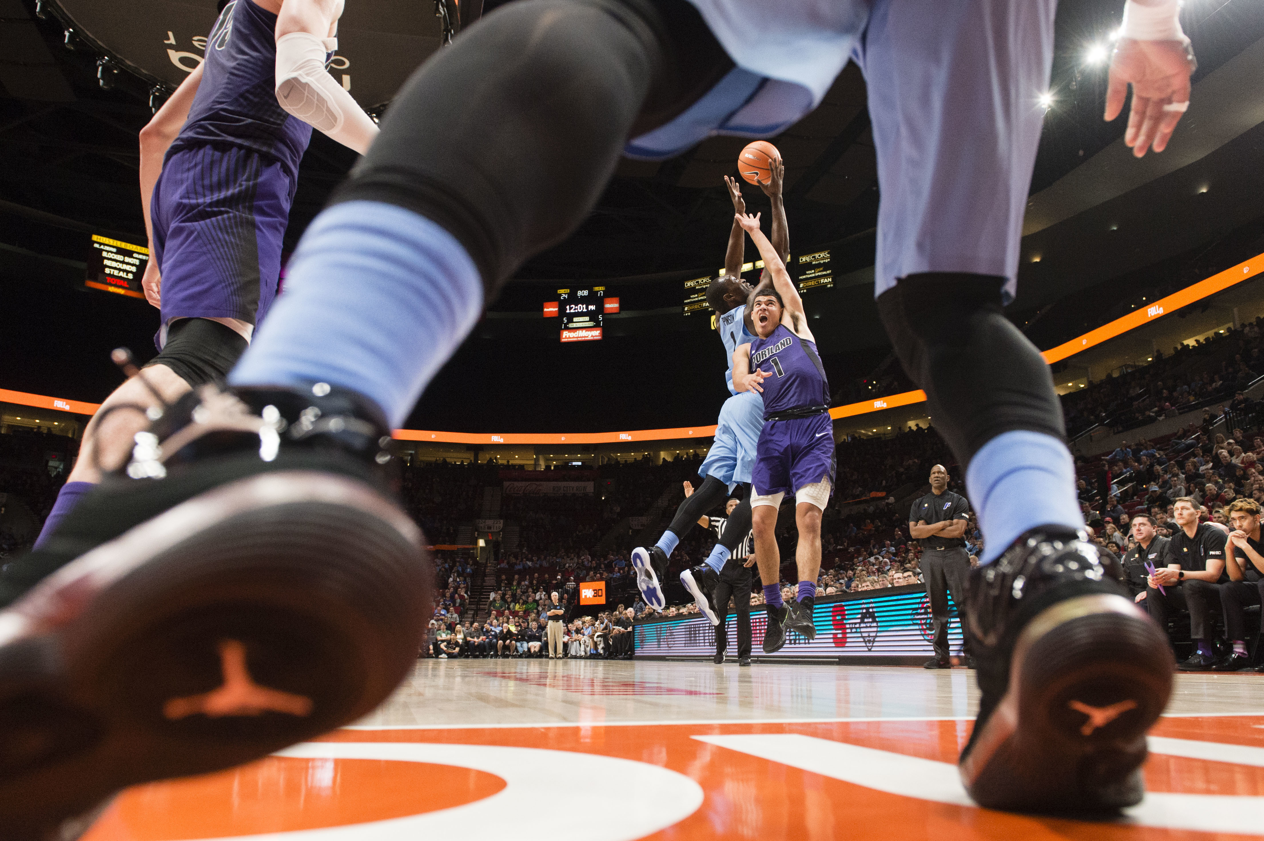 North Carolina forward Theo Pinson, left, and Portland guard Malcolm Porter, right, battle for an inbound pass during the first half in an NCAA college basketball game at the Phil Knight Invitation Tournament, in Portland, Ore., Thursday, Nov. 23, 2017. (AP Photo/Troy Wayrynen)