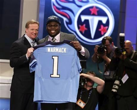 Chance Warmack, from Alabama, stands with NFL Commissioner Roger Goodell after being selected 10th overall by the Tennessee Titans in the first round of the NFL football draft, Thursday night.
