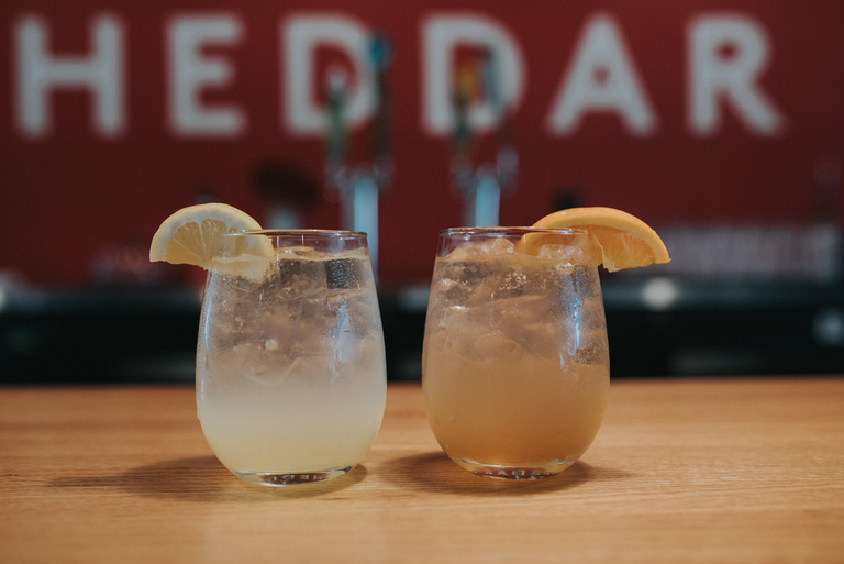 The Lemon Fresher made with Lemon Queen City Shrub, vodka, and soda alongside the Moroccan Nights made with Queen City Shrub, bourbon, soda, and a twist of orange / Image: Brianna Long //{ }Published: 4.11.18