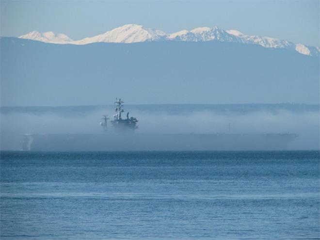 USS Nimitz disappearing in the fog. Passing Whidbey Island (Photo: Katie Kenkins Shaffer)
