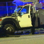 Utility truck crashes into several parked cars in West Seattle