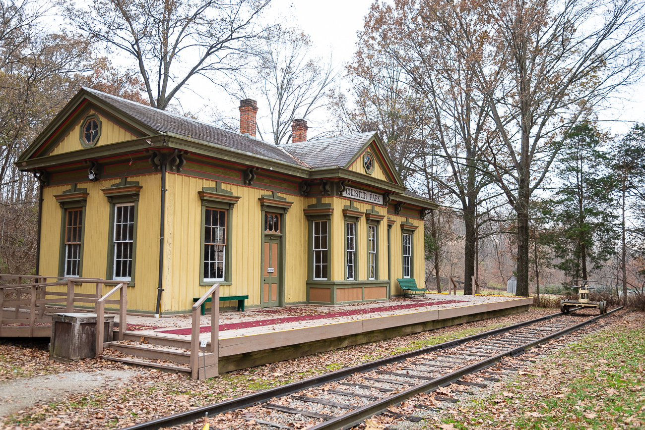 The Chester Park train station was originally located across the road from Chester Park—an amusement park that started as a race track before exploding into a full-fledged destination for swimming and riding rides. The park sat at the corner of Spring Grove and Mitchell Avenue, where the Greater Cincinnati Waterworks offices are located today. At its peak, Chester Park saw thousands of visitors a day, many of whom used the railroad to arrive at the park. After years of decline due to the Great Depression, Prohibition, the advent of cars without room for parking, and competition from Coney Island, Chester Park formally closed in the mid-1950s. The old train station was disassembled and moved to Heritage Village.{ }/ Image: Phil Armstrong, Cincinnati Refined // Published: 12.5.19