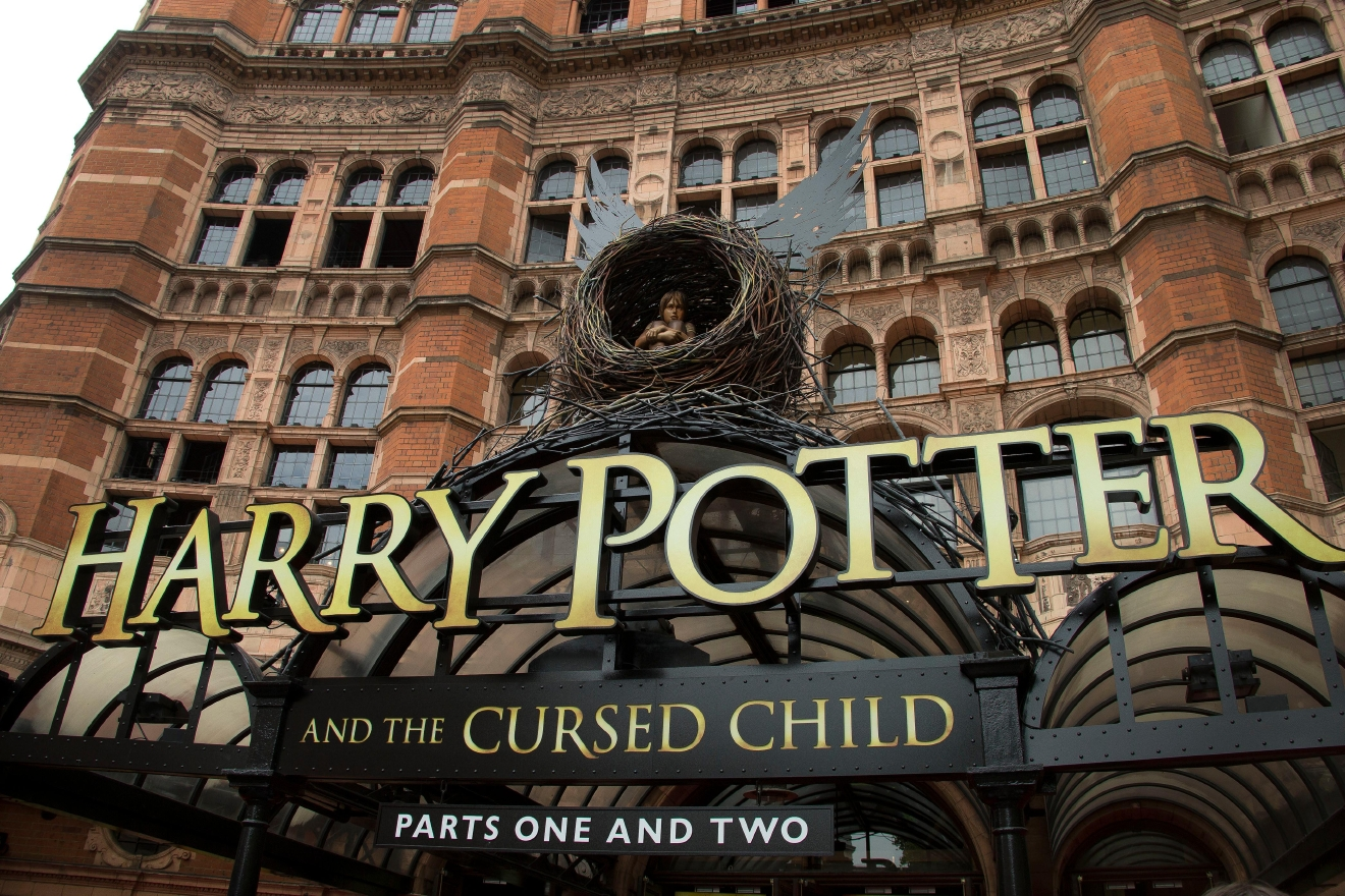 "FILE - This July 30, 2016 photo shows the Palace Theatre in central London which is showing a stage production of, ""Harry Potter and the Cursed Child."" The script ""Harry Potter and the Cursed Child Parts One and Two"" sold more than 2 million print copies in North America in its first two days of publication, Scholastic announced Wednesday, Aug. 3.  (Photo by Joel Ryan/Invision/AP, File)"