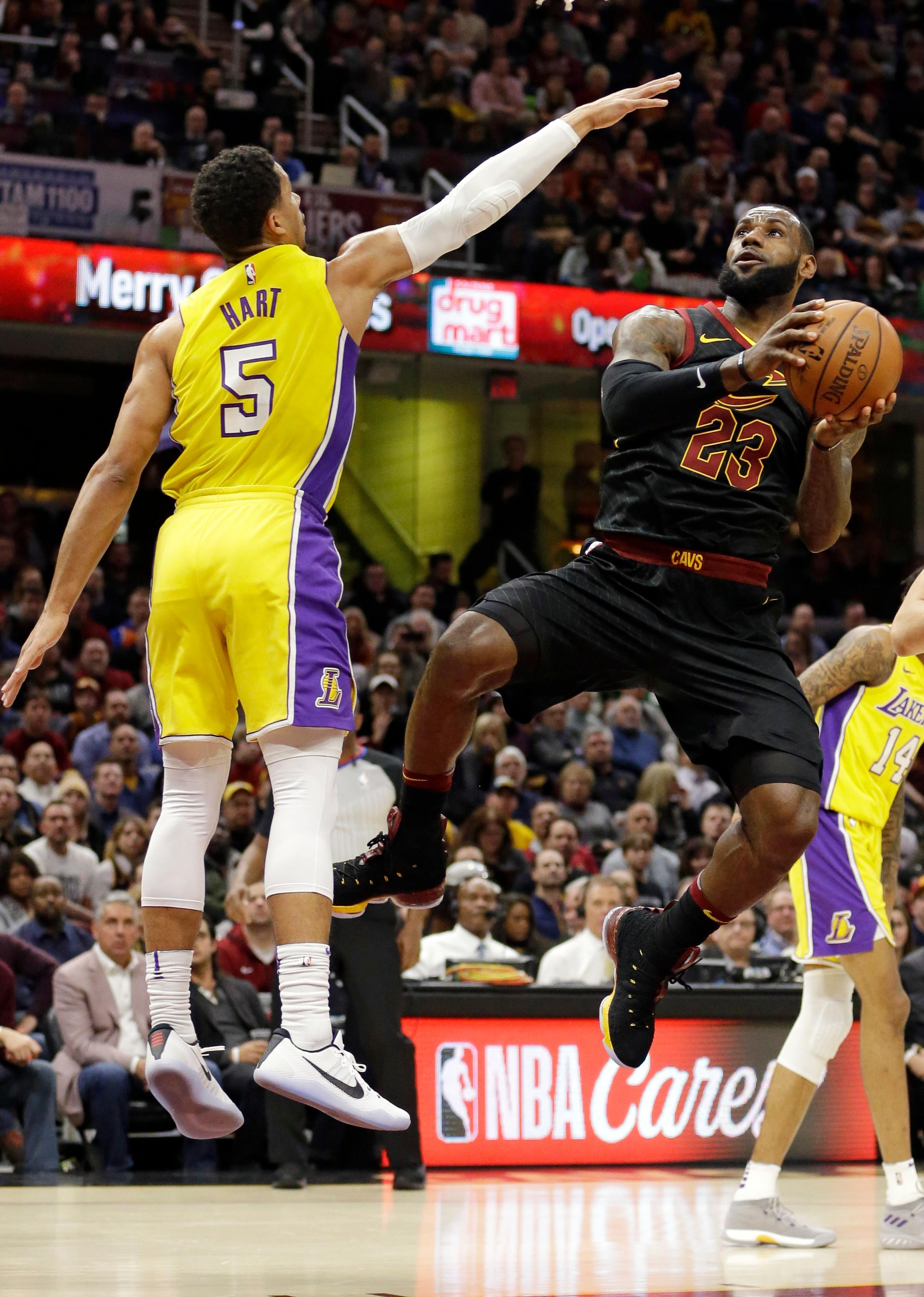 Cleveland Cavaliers' LeBron James (23) drives to the basket against Los Angeles Lakers' Josh Hart (5) in the first half of an NBA basketball game, Thursday, Dec. 14, 2017, in Cleveland. (AP Photo/Tony Dejak)