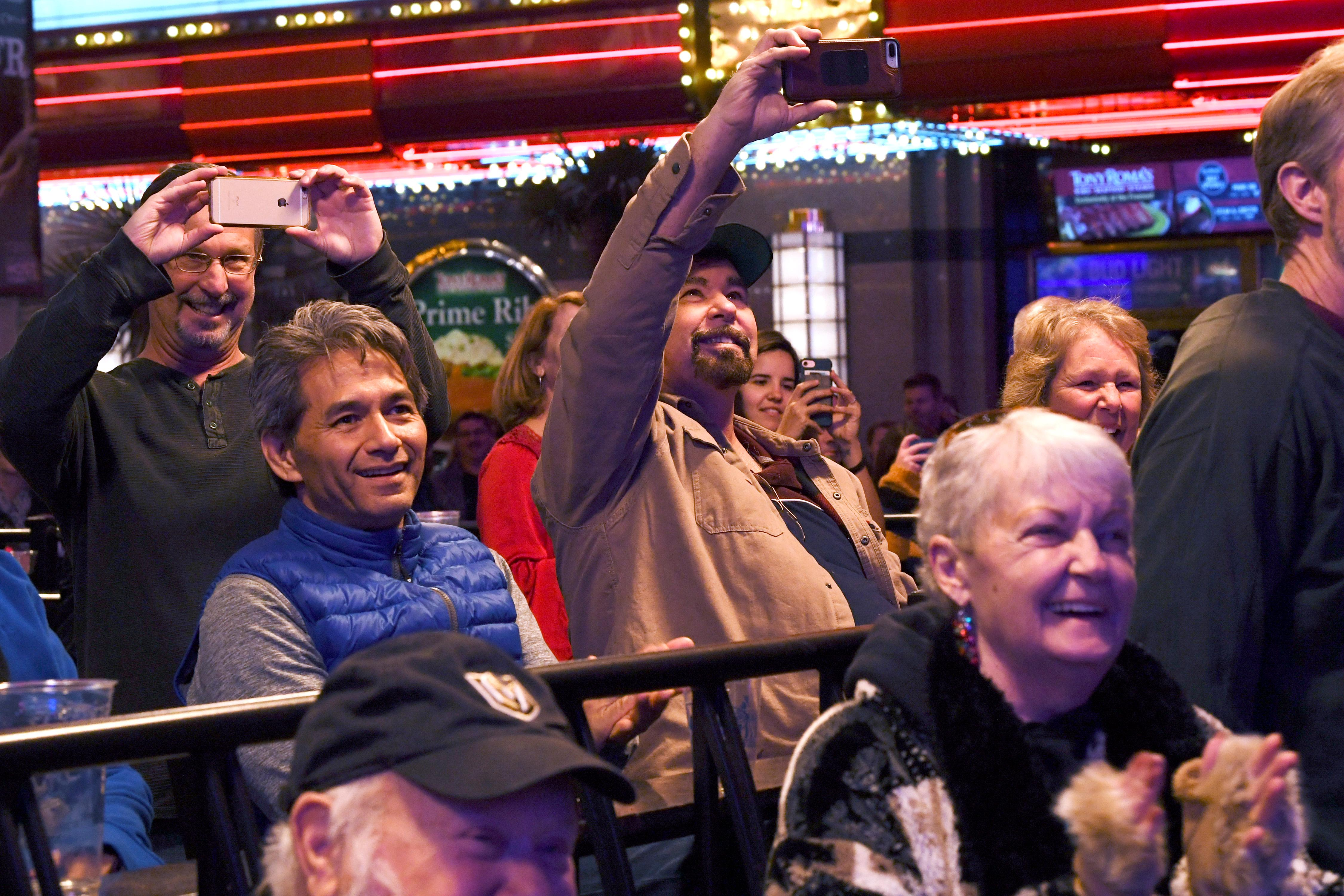 Bystanders enjoy entertainers during the annual lighting of a Christmas tree at the Fremont Street Experience Tuesday, December 4, 2018. CREDIT: Sam Morris/Las Vegas News Bureau