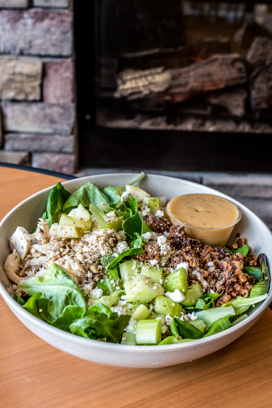 Hot Honey Salad Bowl: Waggle greens, bacon, chicken, celery, granny smith apples, goat cheese, and roasted pecans served with a hot honey vinaigrette / Image: Catherine Viox{ }// Published: 2.10.20