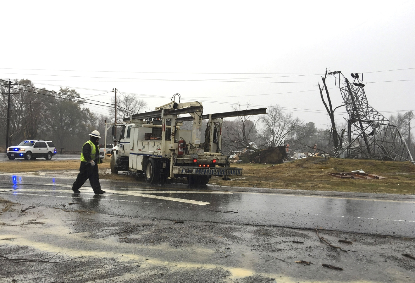 Responders prepare to leave the site of a damaged transformer in Benton Tenn., on Wednesday, Nov. 30, 2016.  Thunderstorms dumped much-needed rain on eastern Tennessee overnight as thousands of people waited anxiously for news about their homes after wildfires tore through the area.  (Paul Leach/Chattanooga Times Free Press via AP)
