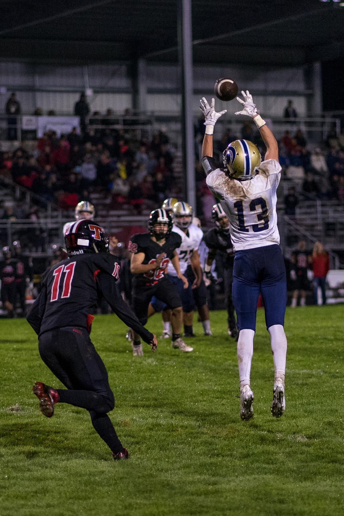 Marist Spartan Hagan Stephenson (#13) completes a reception. The Thurston Colts defeated the Marist Catholic Spartans 50 – 14 to seal second place in their conference at Thurston High School on Friday, October 13. Photo by Kit MacAvoy, Oregon News Lab