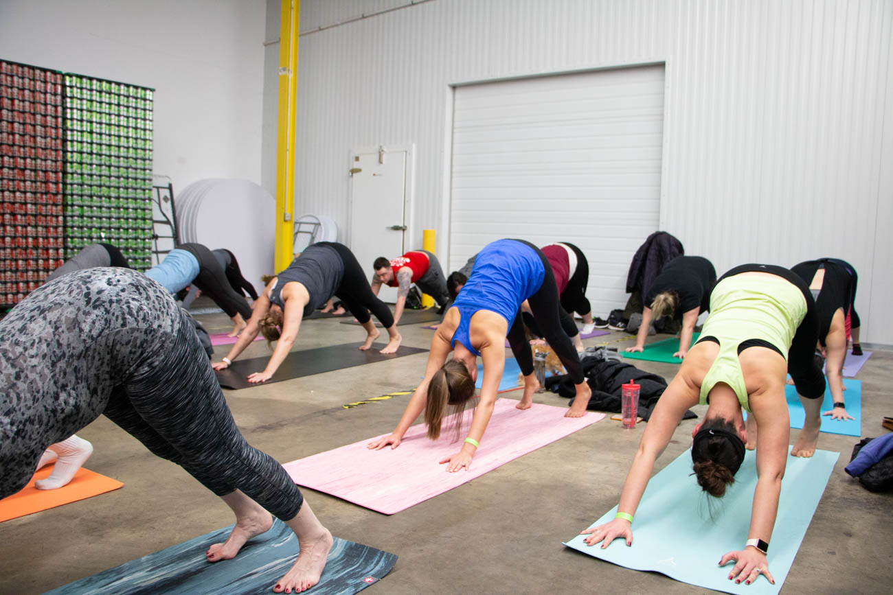 "In an effort to get healthier for 2019, Taft's Brewing Co. began its January Wellness Wednesdays with Dog Yoga—or ""Doga"" in layman's terms. Instructors from Yoga Ah Studio taught the class that took place Wednesday, January 2 in Taft's Brewpourium. Pups were brought in for encouragement and overall cuteness from Recycled Doggies—a fostering organization that takes in shelter dogs on death row to turn them into adoptable pets. Half of the beer sales from the night were donated to the volunteer pupper program. ADDRESS: 4831 Spring Grove Avenue (45232) / Image: Lacey Keith // Published: 1.3.19"