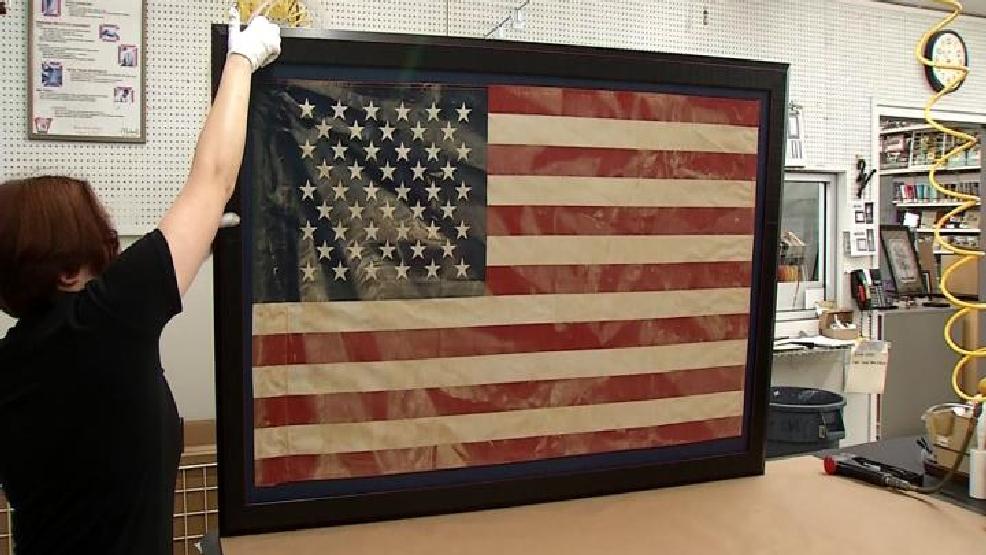 Tattered, mud-covered American flag framed for flood victim as ...