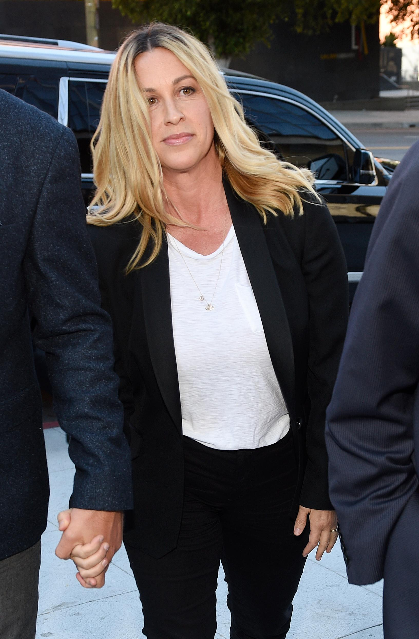Singer Alanis Morissette arrives at U.S. federal court for the sentencing in the embezzlement case of her former manager Jonathan Todd Schwartz, Wednesday, May 3, 2017, in Los Angeles. Schwartz pleaded guilty earlier this year after admitting he embezzled more than $7 million from the singer and other celebrities. (AP Photo/Chris Pizzello)