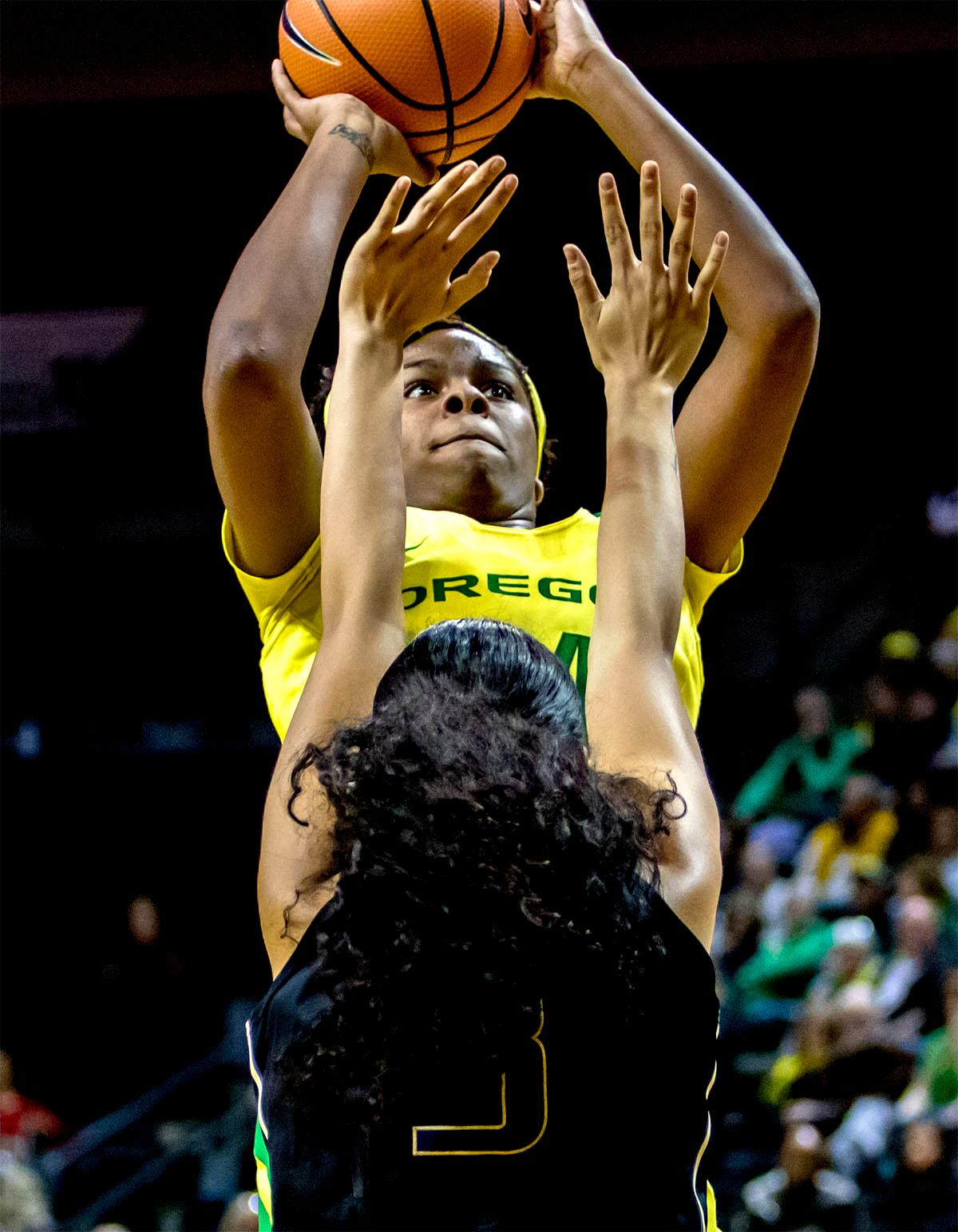 The Duck's Ruthy Hebard (#24) goes up for a basket. The Oregon Ducks defeated the Washington Huskies 94-83 on Sunday at Matthew Knight Arena. The victory was Head Coach Kelly Graves' 500th career win. Sabrina Ionescu also set the new NCAA all time record of 8 triple doubles in just 48 games. The previous record was 7 triple doubles in 124 games, held by Susie McConnell at Penn State. The Ducks will next face off against USC on Friday January 5th in Los Angeles. Photo by Rhianna Gelhart, Oregon News Lab