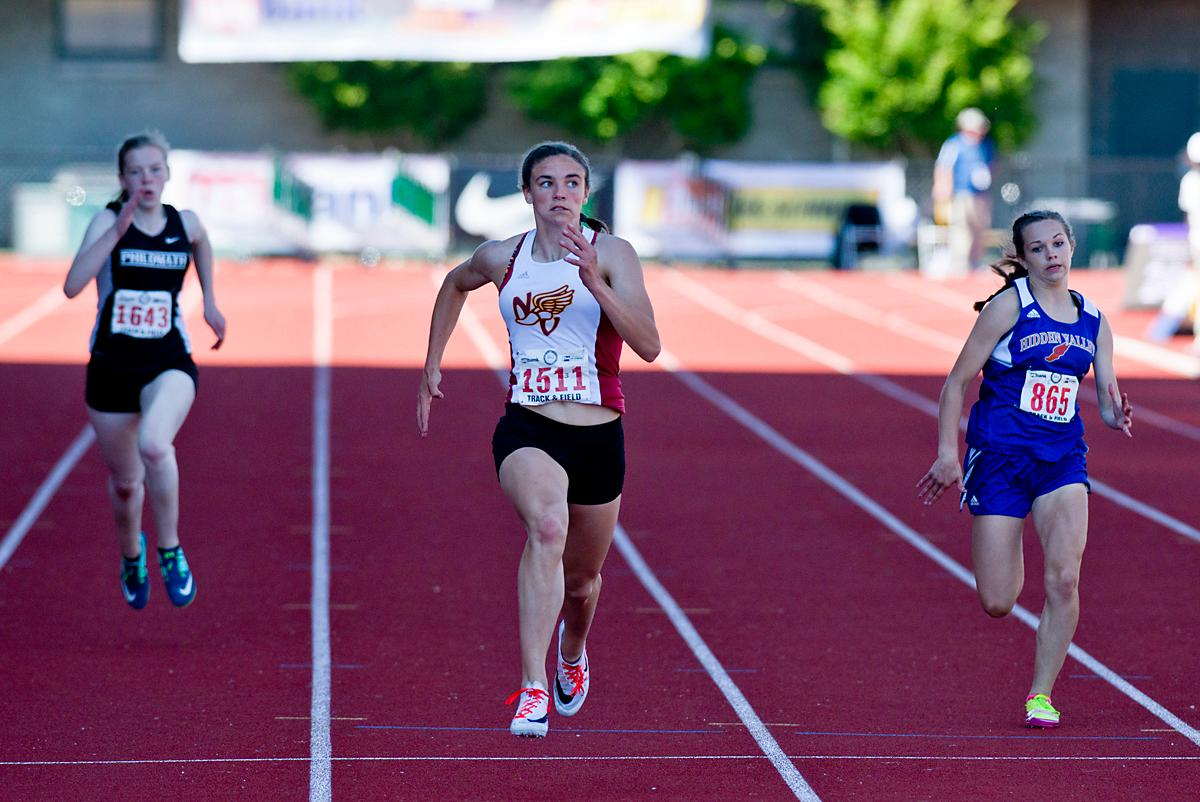 Baylee Touey from North Valley wins the 4A Girls 200 meter Dash with a time of 24.94 at the OSAA Championship at Hayward Field on Saturday. Photo by Dan Morrison, Oregon News Lab