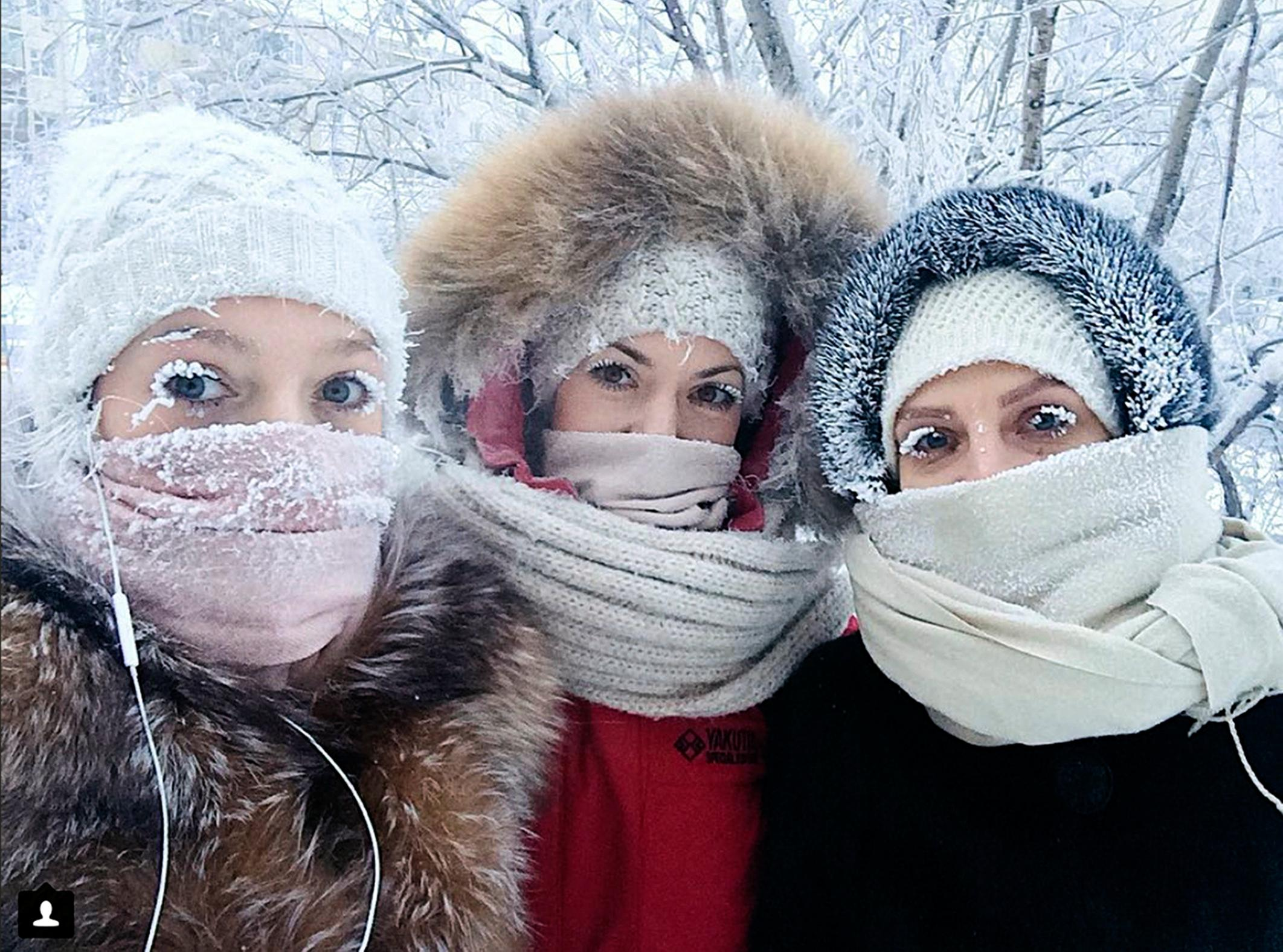 In this photo taken on Sunday, Jan. 14, 2018, Anastasia Gruzdeva, left, poses for selfie with her friends as the temperature dropped to about -50 degrees (-58 degrees Fahrenheit) in Yakutsk, Russia. Temperatures in the remote, diamond-rich Russian region of Yakutia have dropped to near-record lows, plunging to -67 degrees Centigrade (-88.6 degrees Fahrenheit) in some areas. (sakhalife.ru photo via AP)