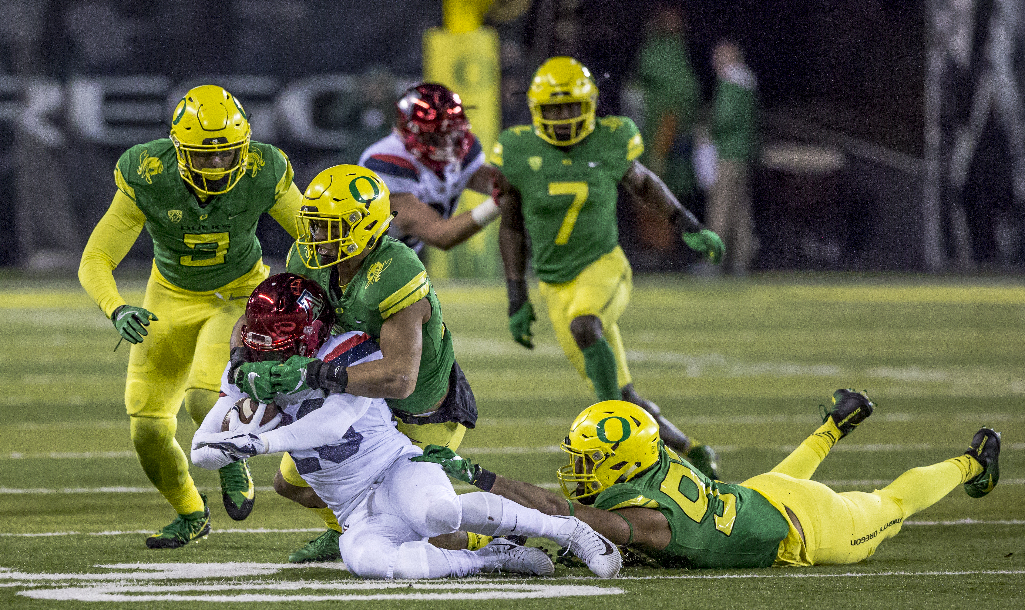 An Oregon defender brings down Arizona running back Nick Wilson (#28). The Oregon Ducks lead the Arizona Wildcats 28 to 21 at the end of the first half at Autzen Stadium on Saturday, November 18, 2017. Photo by Ben Lonergan, Oregon News Lab