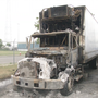 Vandal causes hundreds of dollars in damage after trucks are set ablaze