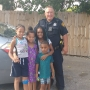 Officer catches kids as they jump from burning apartment