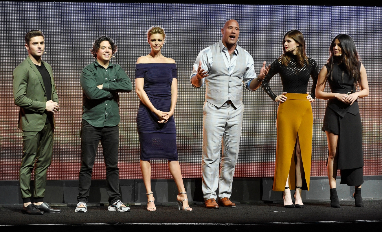"""Baywatch"" cast members, Zac Efron, from left, Jon Bass, Kelly Rohrbach, Dwayne Johnson, Alexandra Daddario and Priyanka Chopra discuss the upcoming film onstage during the Paramount Pictures presentation at CinemaCon 2017 at Caesars Palace on Tuesday, March 28, 2017, in Las Vegas. (Photo by Chris Pizzello/Invision/AP)"