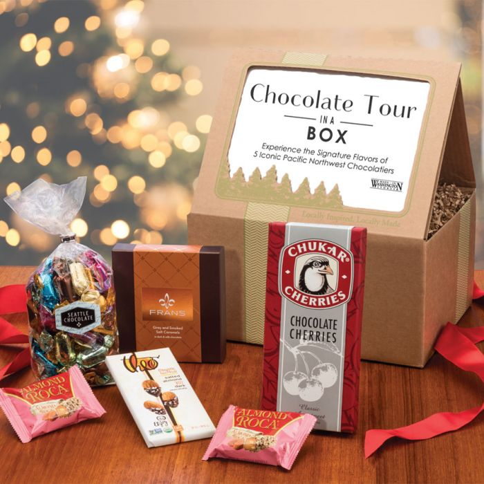 "<p>Indulge in a Collection of Washington's Award Winning Chocolatiers.{&nbsp;} Opt for this{&nbsp;}<a  href=""https://www.madeinwashington.com/chocolate-tour-in-a-box.html"" target=""_blank"" title=""https://www.madeinwashington.com/chocolate-tour-in-a-box.html"">Chocolate Tour in a Box</a>. What better way to taste, compare, explore and indulge in the range of innovative chocolates for which Seattle and Washington have become known for: Fran's Chocolates Salted Caramels; Seattle Chocolate Truffles; Brown & Haley Almond Roca; Theo Chocolate Salted Almond Bar; Chukar Cherries Chocolate Covered Cherries. $80.{&nbsp;}</p><p>(Image: Made In Washington){&nbsp;}</p>"