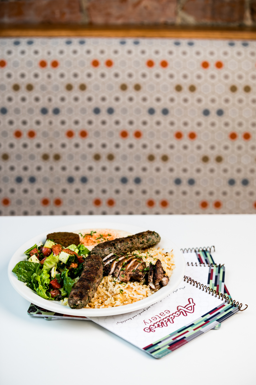 <p>Flavor Savor Special: Chicken mishwi and beef kafta on a bed of seasoned brown rice with vermicelli, served with greens, hummus, and falafel / Image: Amy Elisabeth Spasoff // Published: 7.19.18</p>
