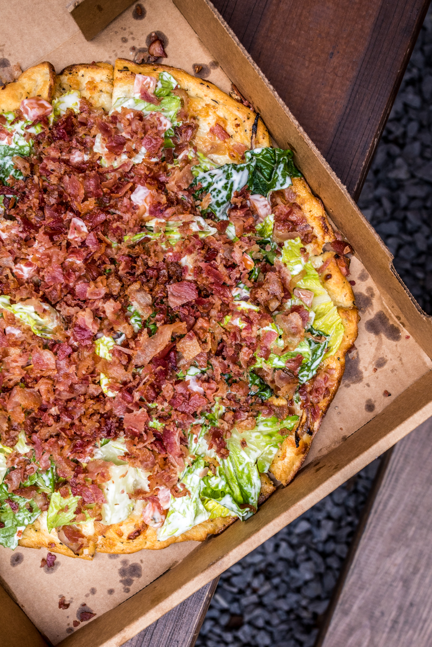 BLT Pizza: this award-winning pie is topped with bacon, lettuce, tomato, ranch, red onion, and chicken / Image: Catherine Viox{ }// Published: 4.6.20