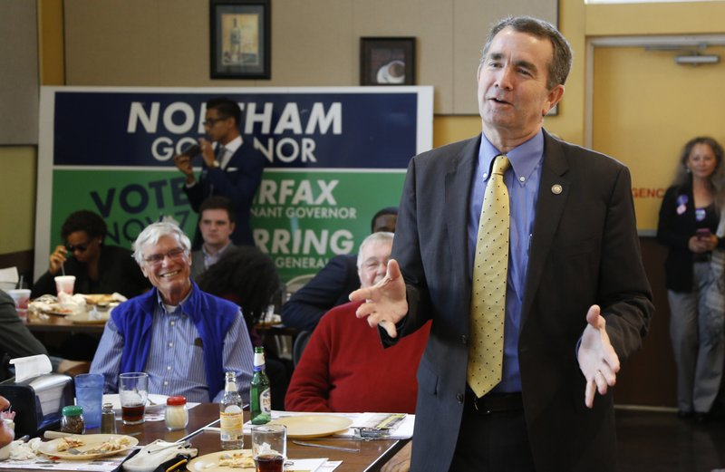 Democratic gubernatorial candidate Ralph Northam speaks with voters at a restaurant in Berryville, Va., Wednesday Oct. 25, 2017. Northam may have a politician's dream background, but he's still struggling with how to define himself in the age of Trump. (AP Photo/Steve Helber)