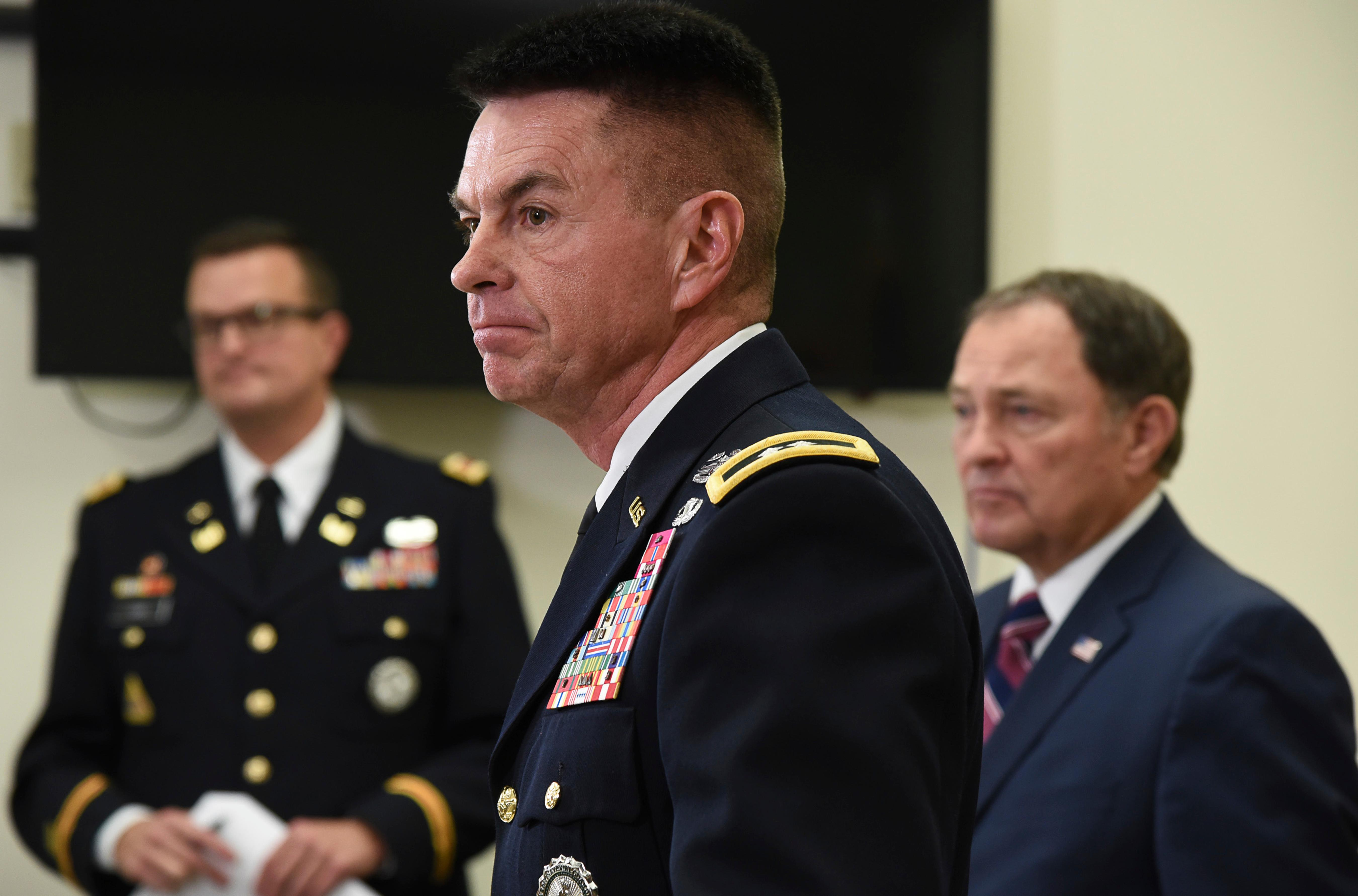 Maj. Gen. Jefferson S. Burton, center, address the media on Sunday, Nov. 4, 2018, in Draper, Utah. Military officials say a major in Utah's Army National Guard who was also the mayor of a city north of Salt Lake City was killed in Afghanistan after being shot by a member of the Afghan security forces. They say North Ogden Mayor Brent Taylor was in the country to train Afghan commandos and was shot Saturday, Nov. 3, 2018, by one of the trainees at the Kabul military training center. The attacker was then killed by Afghan forces. (Francisco Kjolseth/The Salt Lake Tribune, via AP)