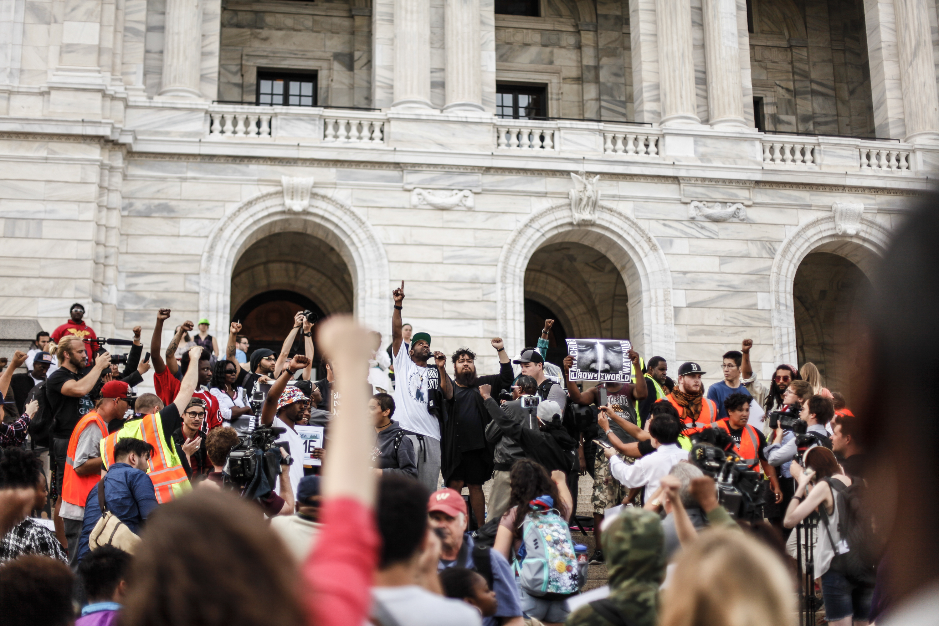 Protesters and family members of Philando Castile gather outside the state Capitol in St. Paul, Minn., Friday June 16, 2017. A Minnesota police officer was cleared earlier Friday in the fatal shooting of Castile, a black motorist whose death captured national attention when his girlfriend streamed the grim aftermath on Facebook. (Maria Alejandra Cardona/Minnesota Public Radio via AP)