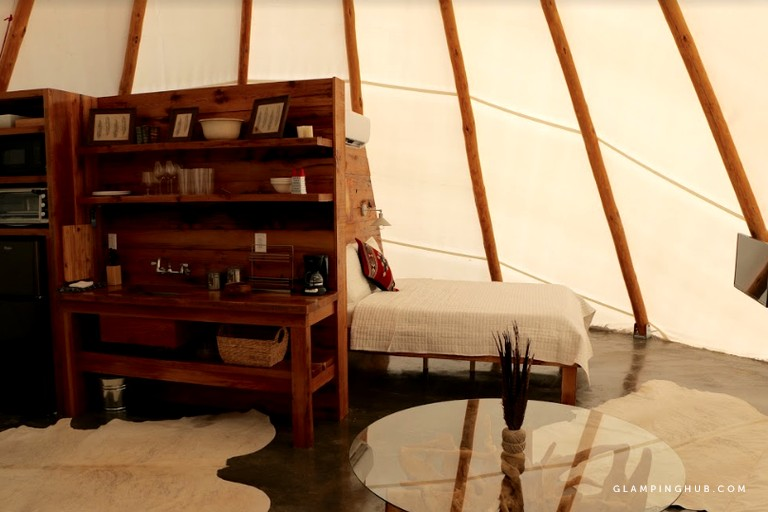 This tipi in central Virginia is stylishly furnished with a modern-rustic interior that will comfortably sleep up to four guests, with a queen bed and an additional fold-out queen sofa bed. (Image: Courtesy Glamping Hub)<p></p>