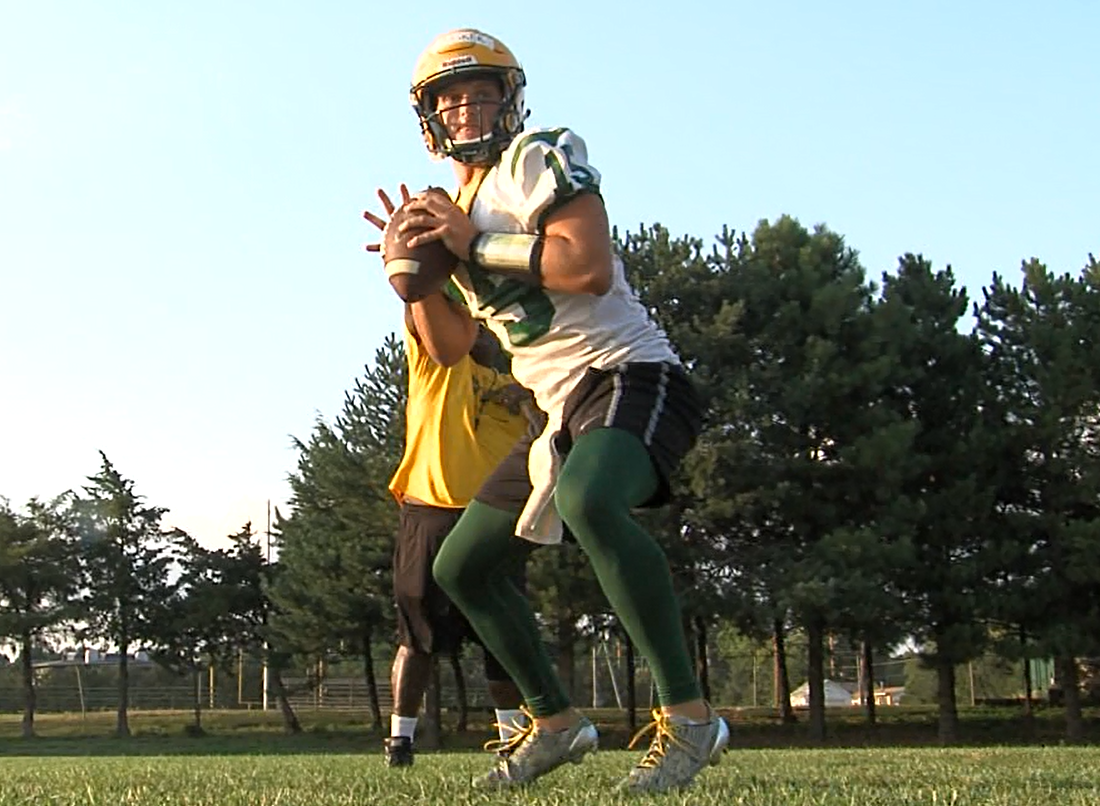 Matt Masker, a quarterback at Kearney Catholic, works on his progressions and footwork on Aug. 7, 2017 (KHGI)