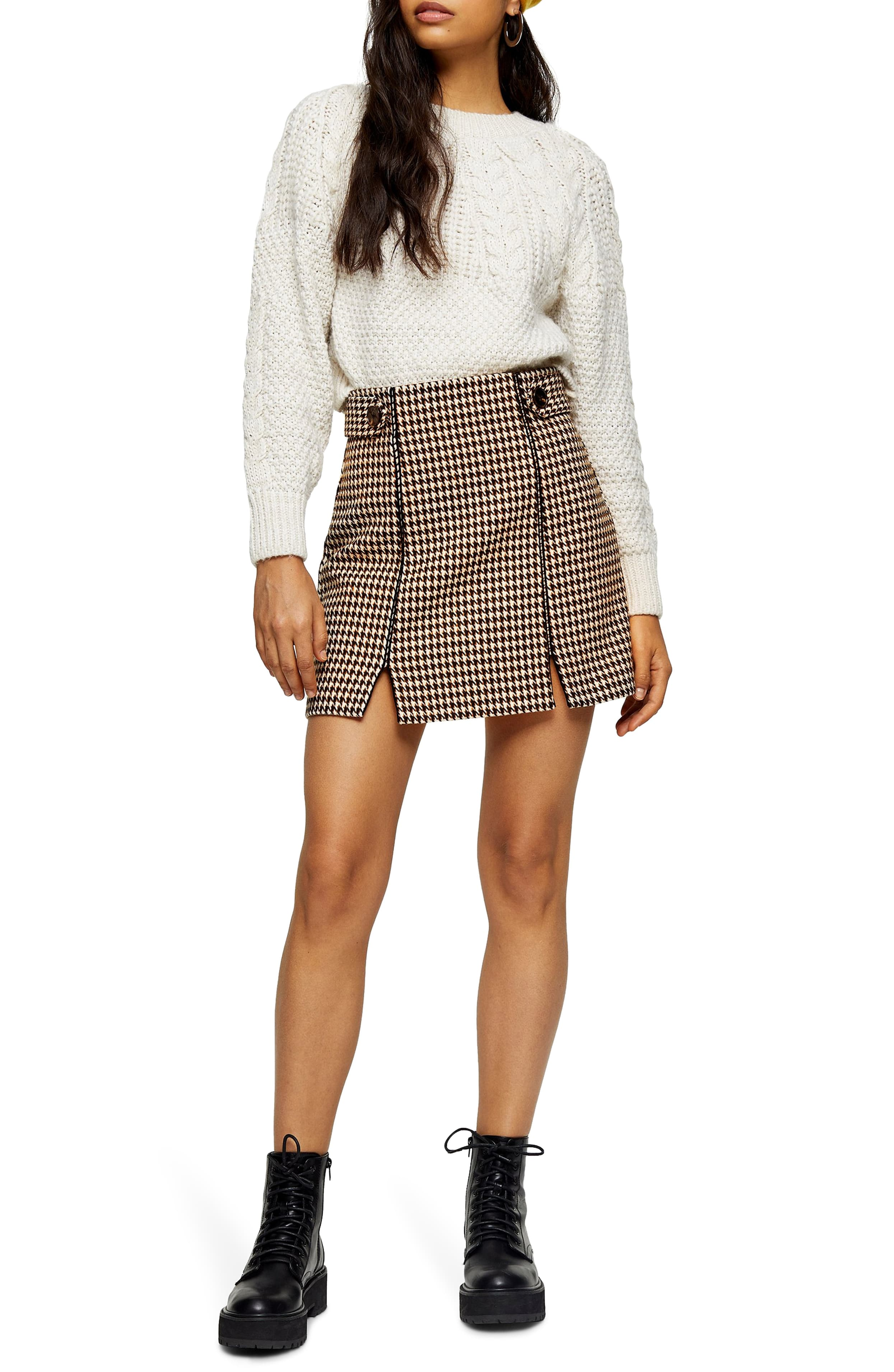 "<p>A houndstooth pattern adds old-school charm to a miniskirt completed with a flirty split hemline. $60{&nbsp;}</p><p><a  href=""https://shop.nordstrom.com/s/topshop-houndstooth-miniskirt/5501119/full?origin=category-personalizedsort&breadcrumb=Home%2FWomen%2FShop%20by%20Occasion%2FNight%20Out&color=cream%20multi"" target=""_blank"" title=""https://shop.nordstrom.com/s/topshop-houndstooth-miniskirt/5501119/full?origin=category-personalizedsort&breadcrumb=Home%2FWomen%2FShop%20by%20Occasion%2FNight%20Out&color=cream%20multi"">Shop it{&nbsp;}</a></p><p>(Image: Nordstrom){&nbsp;}</p>"