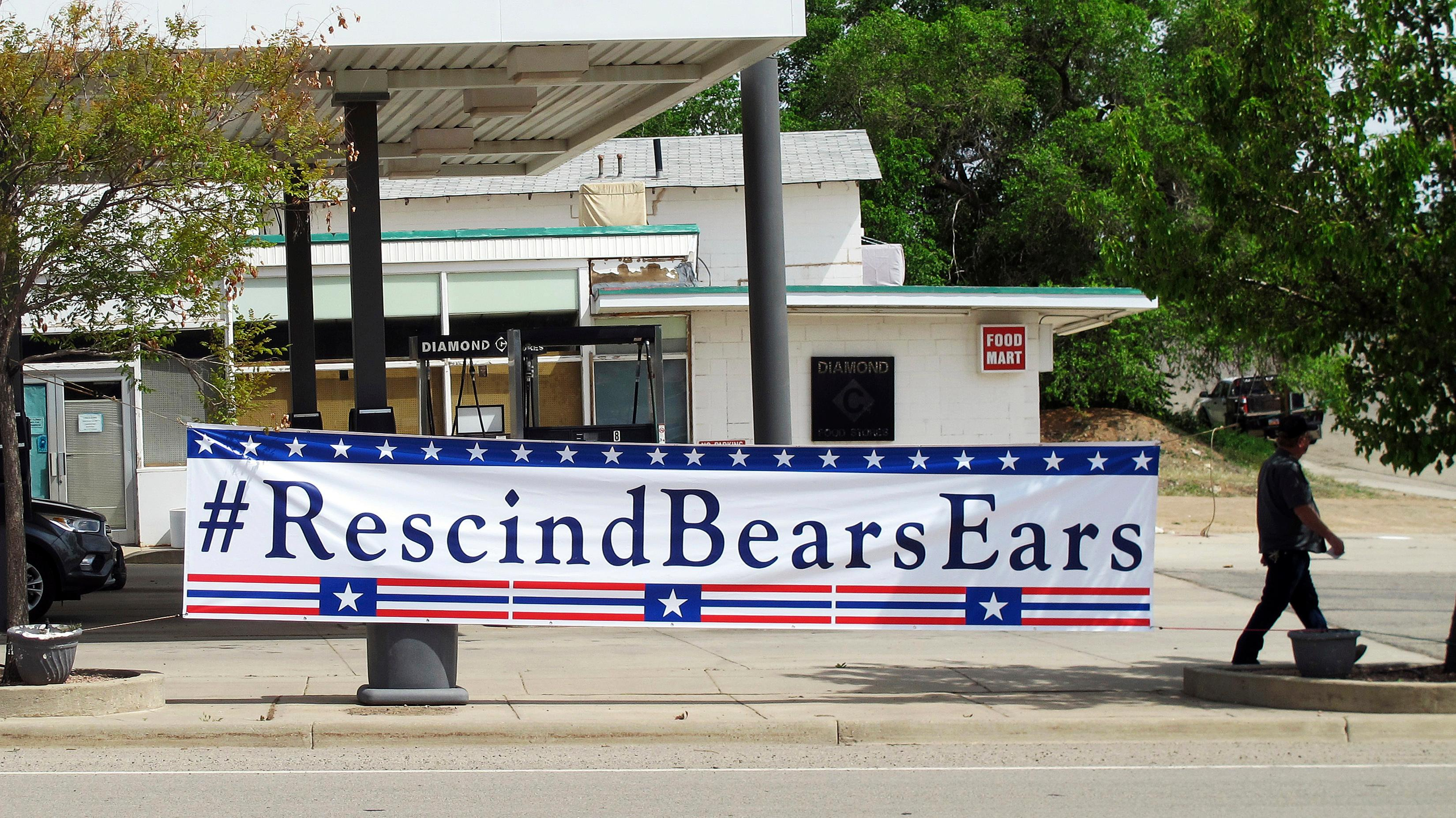 A banner sign hangs in Blanding, Utah, Monday, May 8, 2017. U.S. Interior Secretary Ryan Zinke Zinke flew Monday morning, May 8, 2017, from Salt Lake City to Blanding, Utah, where he took a helicopter tour along with Utah Gov. Gary Herbert to see Bears Ears National Monument on lands considered sacred to a coalition of five tribes. (AP Photo/Michelle Price)