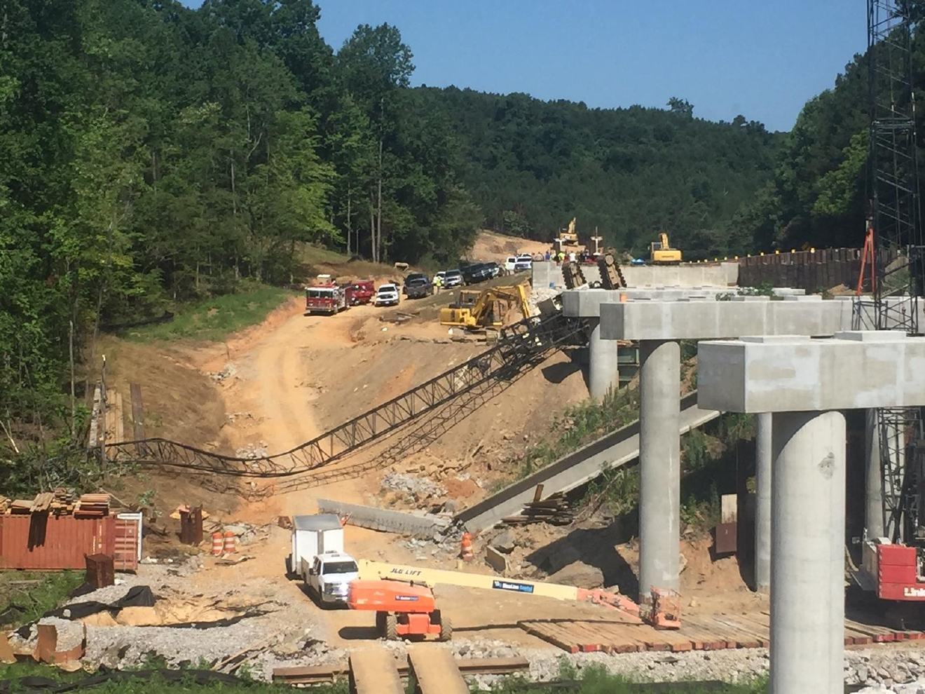 An overturned crane at the crash site in Parrish near Highway 269 in Walker County, Ala., Monday, June 13, 2016. (abc3340.com)