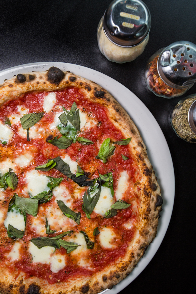 Margherita pizza: San Marzano tomatoes, fresh mozzarella, basil, parmigiano-reggiano, and extra virgin police oil / Image: Catherine Viox // Published: 6.17.19
