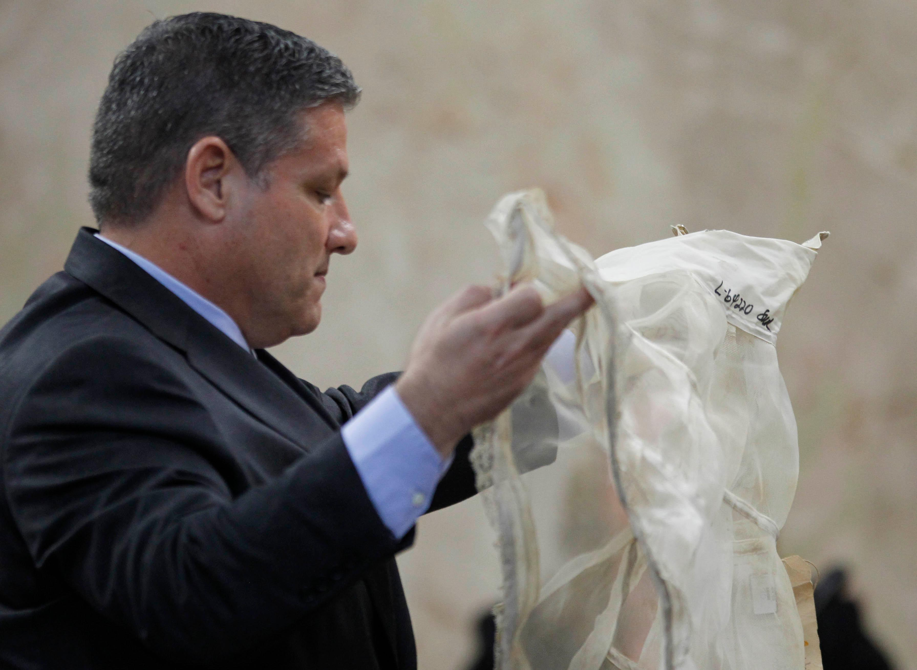 Hidalgo County Assistant District Attorney Michael Garza holds up the petticoat worn by Irene Garza when her body was discovered in 1960 during testimony in John Bernard Feit's trial for the murder of Garza Wednesday, December 6, 2017, at the Hidalgo County Courthouse in Edinburg. (Nathan Lambrecht/The Monitor/Pool)