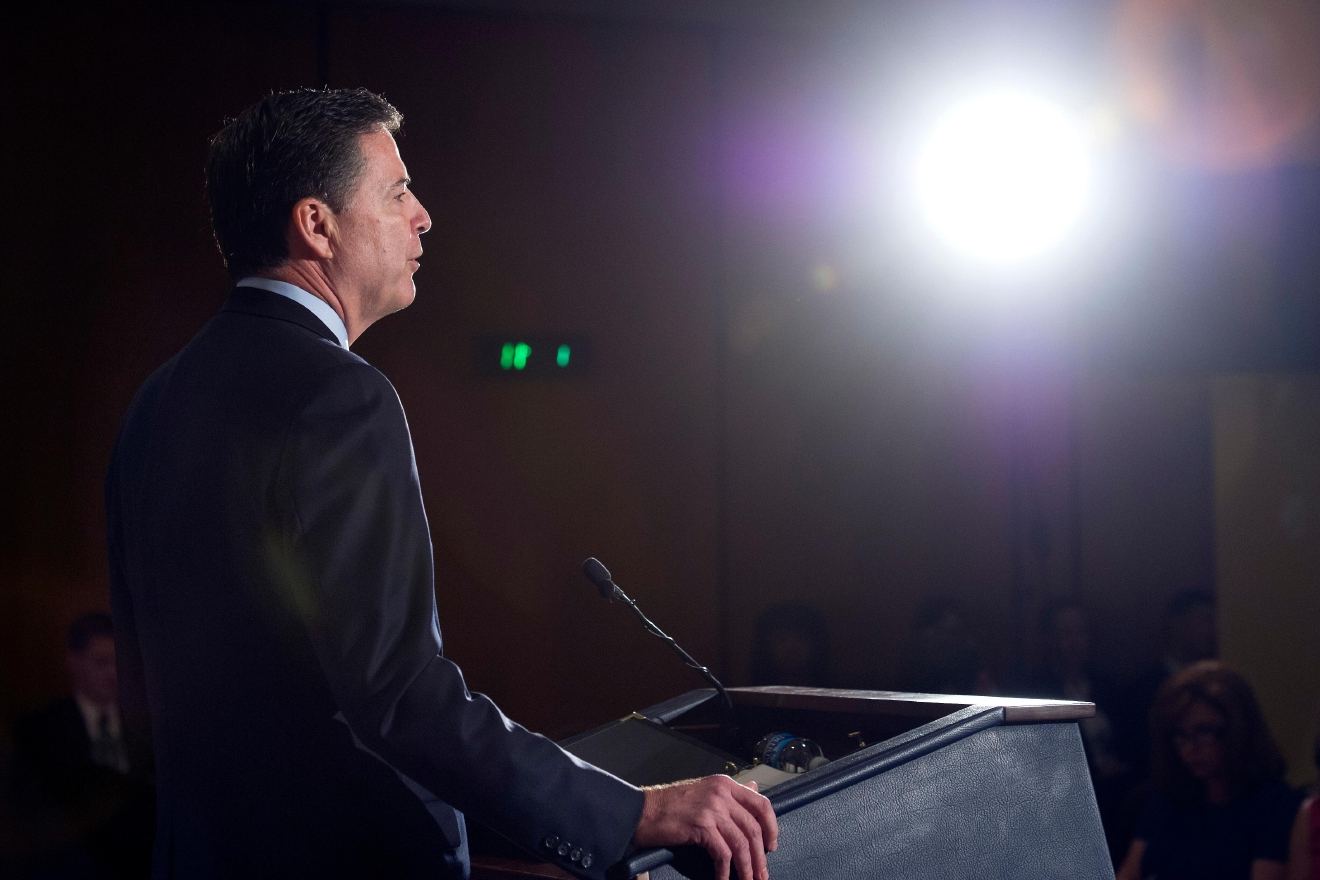 FBI Director James Comey makes a statement at FBI Headquarters in Washington, Tuesday, July 5, 2016. Comey said the FBI will not recommend criminal charges in its investigation into Hillary Clinton's use of a private email server while secretary of state. (AP Photo/Cliff Owen)