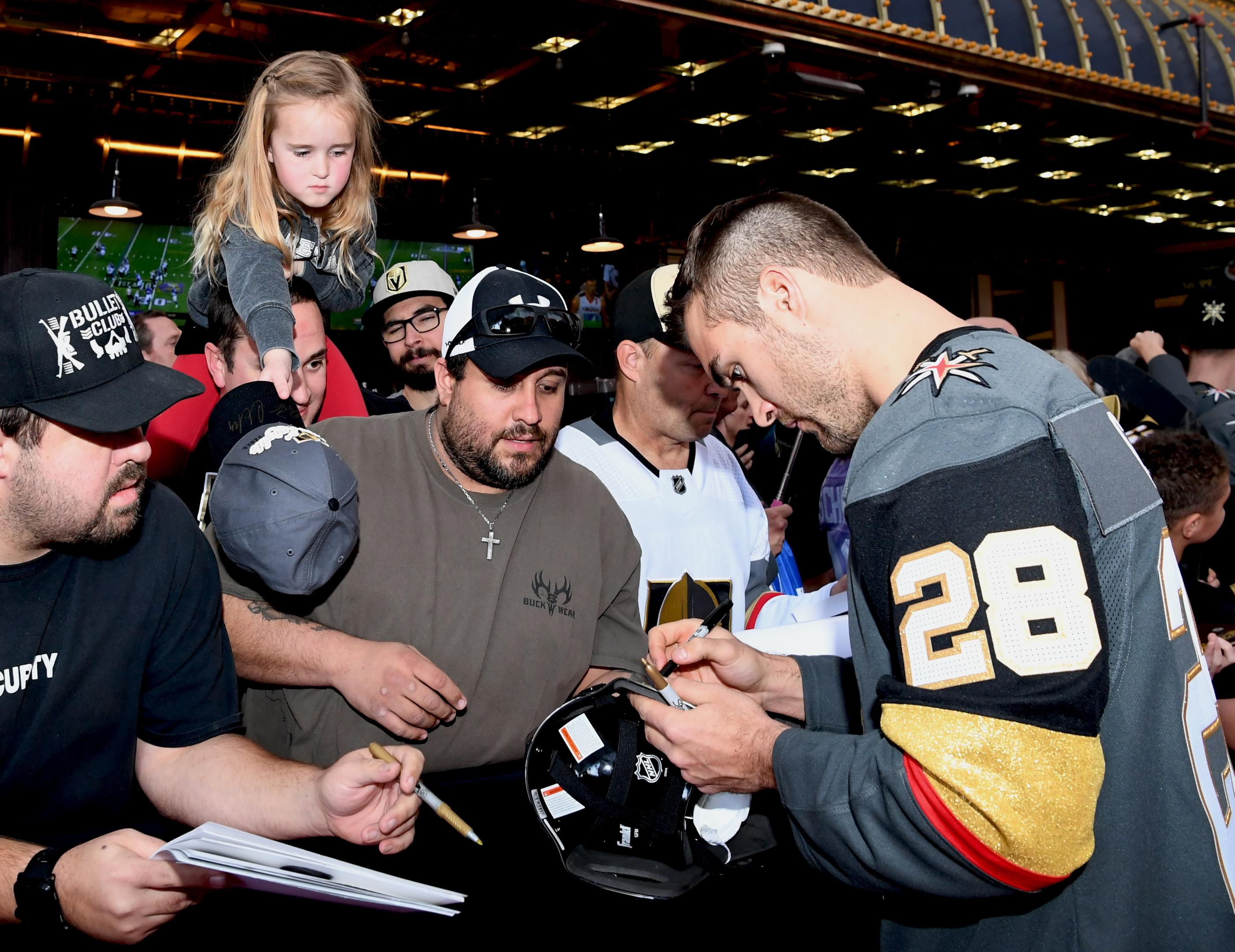 The Golden Knights host a Fan Fest with the D Las Vegas and Fremont Street Experience. A young fan reaches down to get an autograph fromLas Vegas Golden Knights player William Carrier at Fremont Street Experience. Sunday, January 14, 2017. CREDIT: Glenn Pinkerton/Las Vegas News Bureau