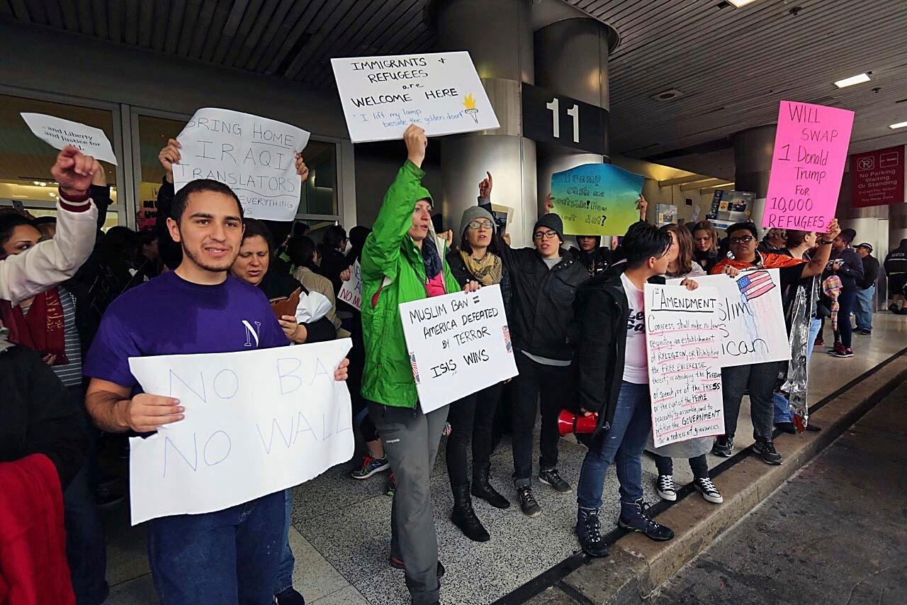 Protesters rally against President Trump's refugee ban at Miami International Airport on Sunday, Jan. 29, 2017.President Donald Trump's immigration order sowed more confusion and outrage across the country Sunday, with travelers detained at airports, panicked families searching for relatives and protesters registering their opposition to the sweeping measure. (C.M. Guerrero/El Nuevo Herald via AP)