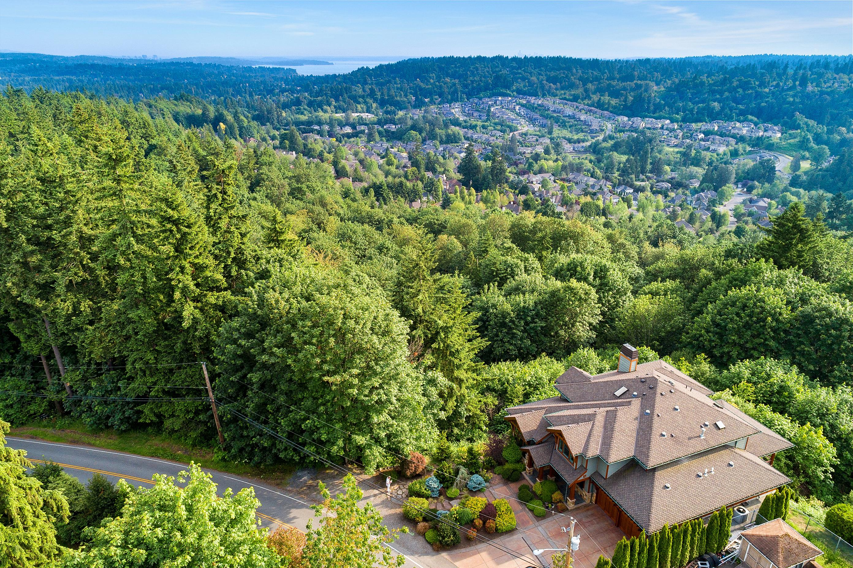 This beautiful Bothell home is not only surrounded by lush green scenery but was the winner of the 2018 HGTV Ultimate House Hunt! The Craftsman Estate exhibits outstanding craftsmanship, complete privacy and awe-inspiring, 180 degree views. The home is custom built and designed to provide the ultimate indoor to outdoor living and entertaining experience. There is both south and west exposure with walls of windows. In the lower level of the home, there is over 2000 square feet of living space with a media room, second kitchen, second utility room, bedroom and bonus room.{ }Listed by Windermere, the Bothell home is 5,840 square feet with 4 beds, 4 baths and is listed for $2M. (Image courtesy of Windermere).