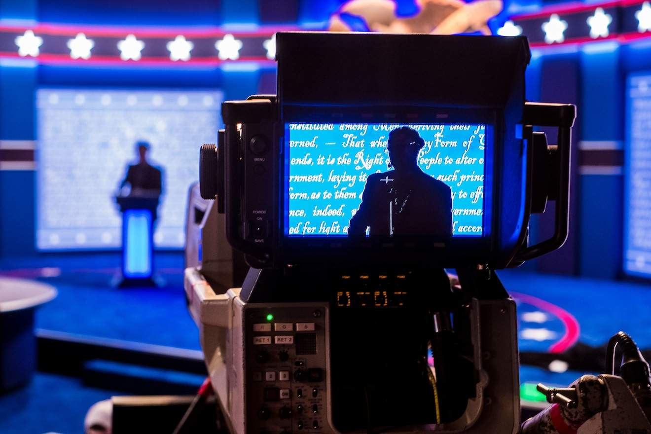 A stand-in for Republican presidential candidate Donald Trump is seen in a television camera monitor as preparations continue Sunday Sept. 25, 2106 for the presidential debate at Hofstra University in Hempstead, N.Y. (AP Photo/J. David Ake)