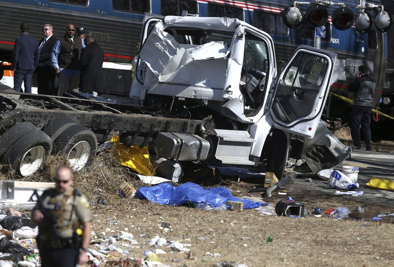 <p>Wreckage is seen near the scene of where an Amtrak train carrying multiple Republican lawmakers crashed into a garbage truck in Crozet, Va., on Wednesday, Jan. 31, 2018. A chartered train carrying dozens of GOP lawmakers to a Republican policy retreat in West Virginia struck a garbage truck in a rural Virginia town Wednesda. (Zack Wajsgras/The Daily Progress via AP)</p>