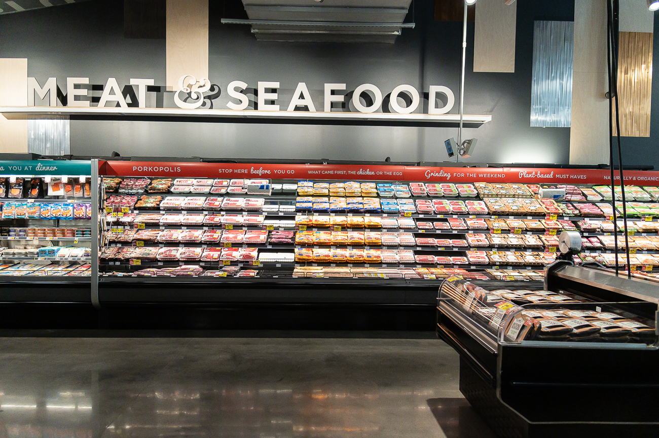 The meat and seafood department, as well as the bakery department, do not have personnel behind a counter like the suburban model. With its emphasis on convenience, those goods are packaged and ready to be picked up without needing help from a Kroger employee. Removing counters allows for more space in the store to be used for product. / Image: Phil Armstrong, Cincinnati Refined // Published: 9.24.19