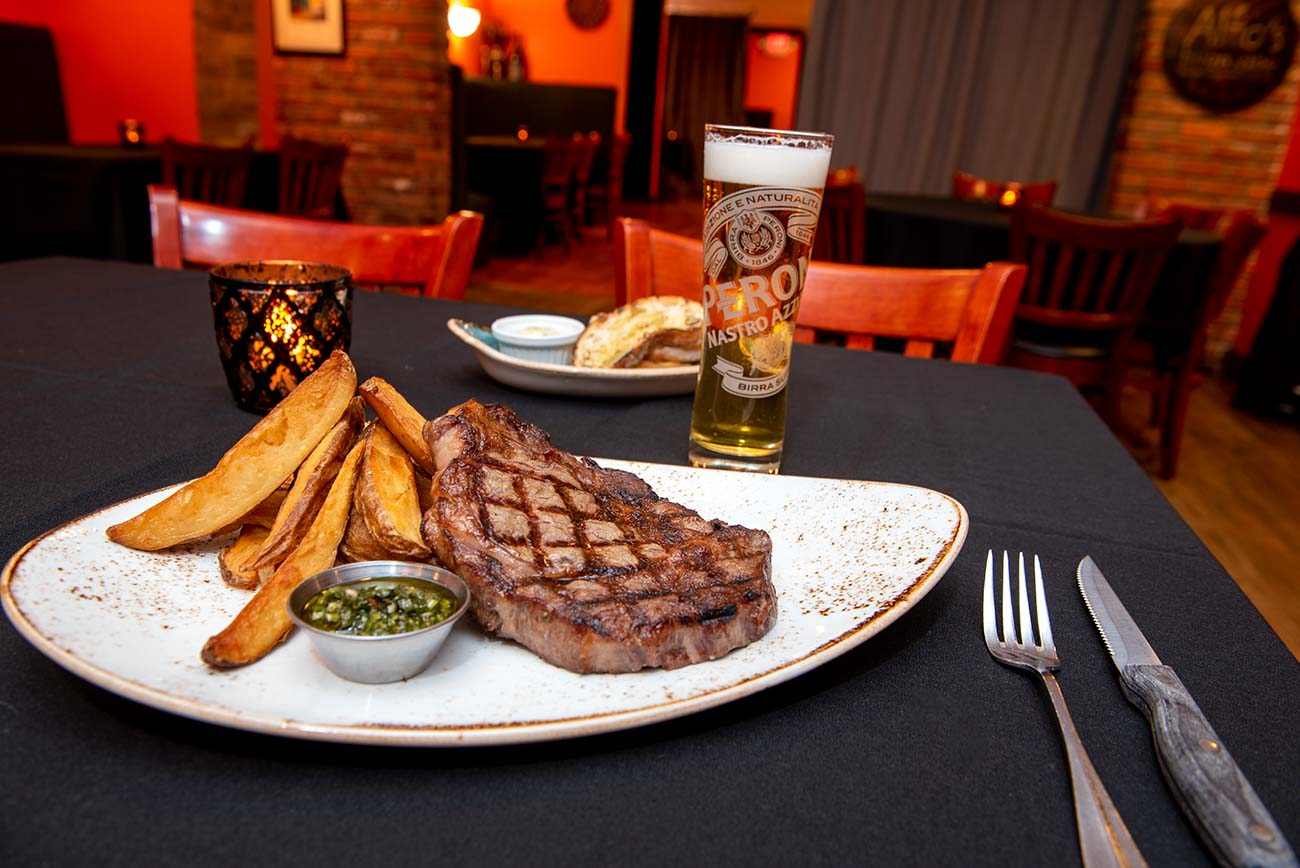 Argentine Ribeye: 13 oz prime ribeye served with steak fries and topped with traditional Argentine Chimichurri / Image: Joe Simon // Published:  6.25.20