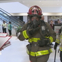 Firefighters haul gear up 26 floors for lung cancer benefit