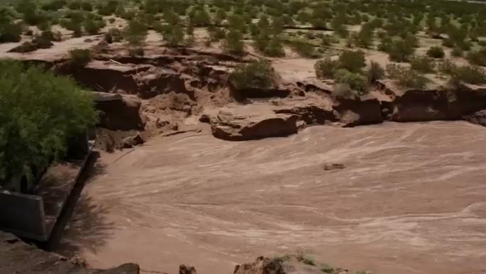 CBS4 Eye in the Sky drone footage of cleanup efforts after floods damaged roads and homes in Clint. (CBS4)