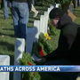 Veterans' gravesites adorned with wreaths, but not all of them
